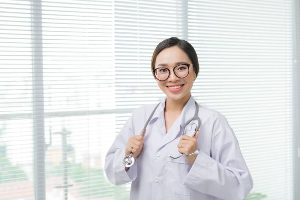Doctor woman. Medical physician female doctor over clinic interior background. stock photo