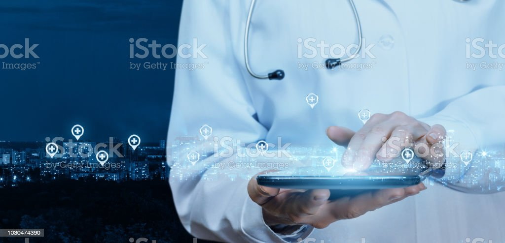 Doctor working at the medical network on the tablet . stock photo
