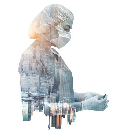 Double exposure of a female doctor working in New York during the COVID-19 pandemic and wearing PPE