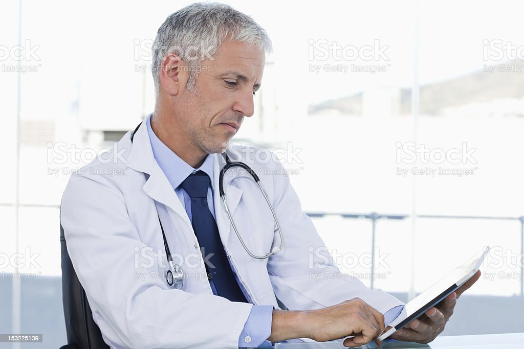 Doctor working with a tablet computer royalty-free stock photo