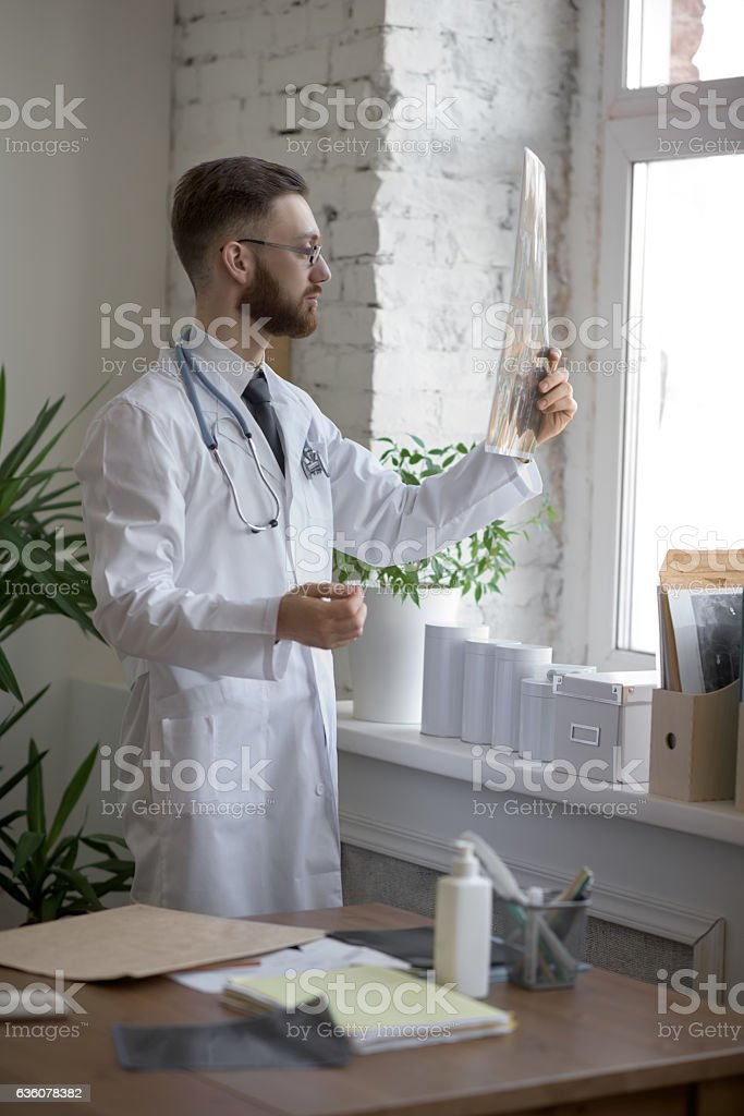 Doctor working with ct scan stock photo
