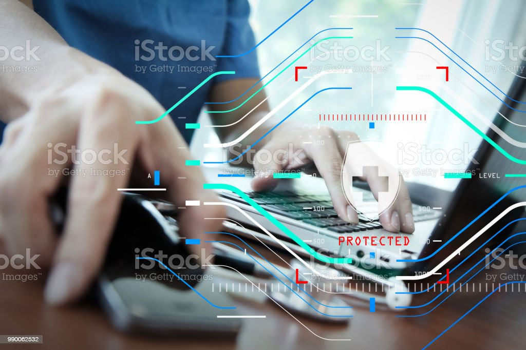 Doctor working with laptop computer in medical workspace office as concept stock photo