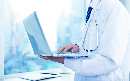 istock Doctor working with laptop 511069368