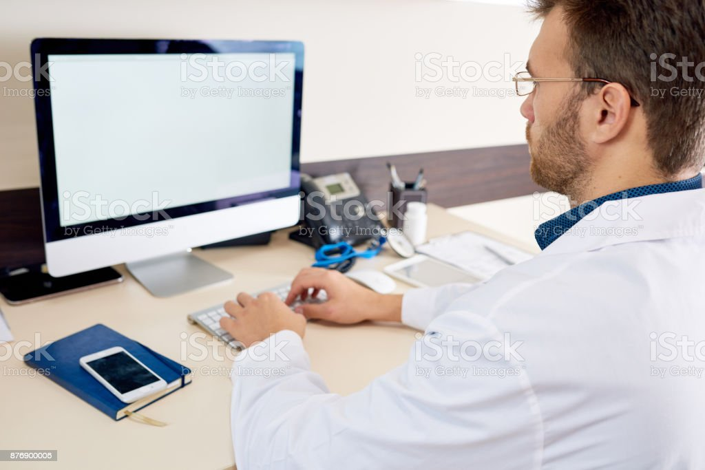 Doctor Working with PC stock photo