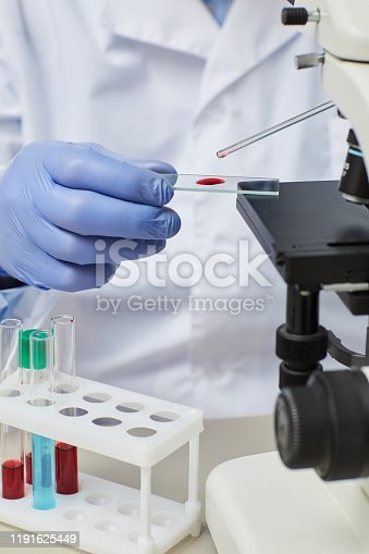 162264253 istock photo Doctor working with samples 1191625449