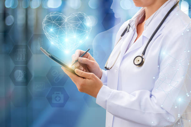 Doctor works on your computer . Doctor works on your computer on blurred background. signature collection stock pictures, royalty-free photos & images