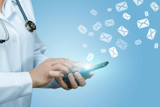 Doctor works with letters in envelopes . stock photo