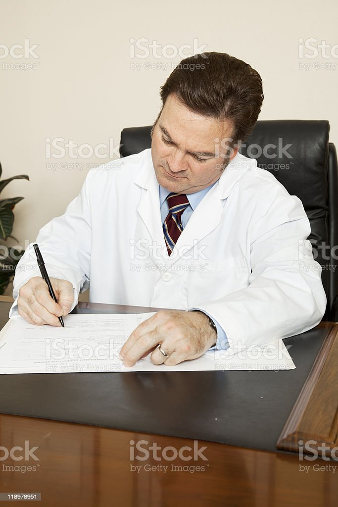 Doctor Writes in Chart royalty-free stock photo