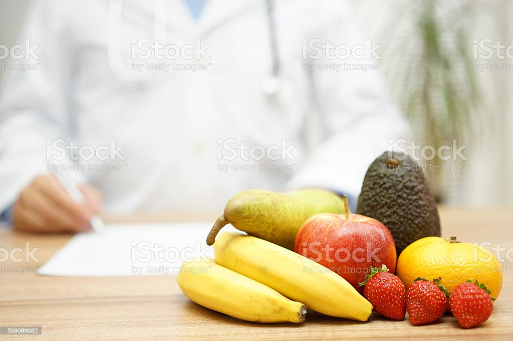 Doctor writes the prescription for diet stock photo