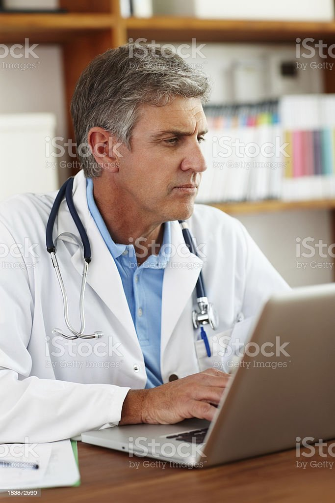 Doctor writing a patient's journal royalty-free stock photo