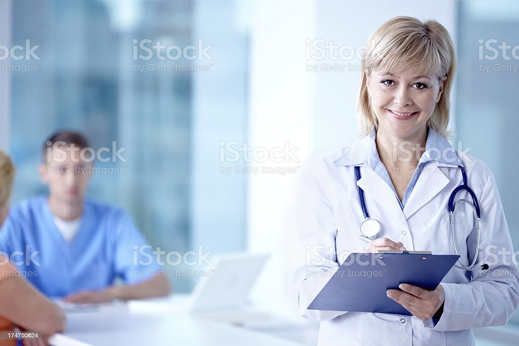 Doctor writing a report royalty-free stock photo