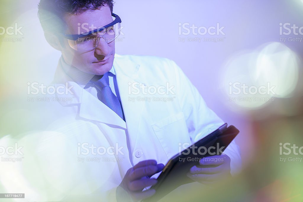Doctor writing notes in digital tablet royalty-free stock photo