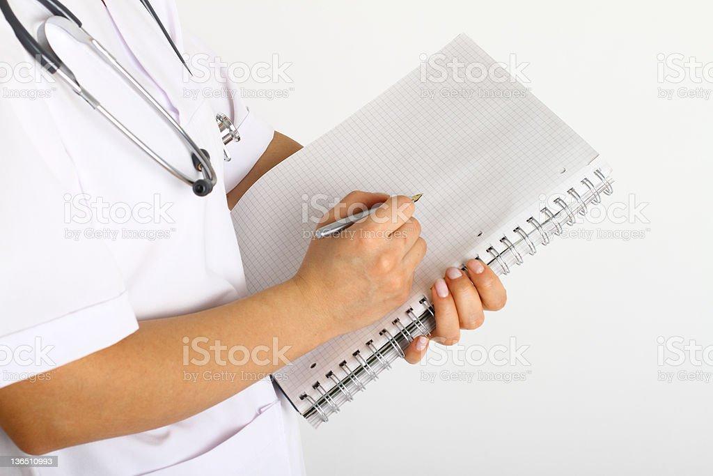 Arzt Schreiben auf Diagrammen – Foto