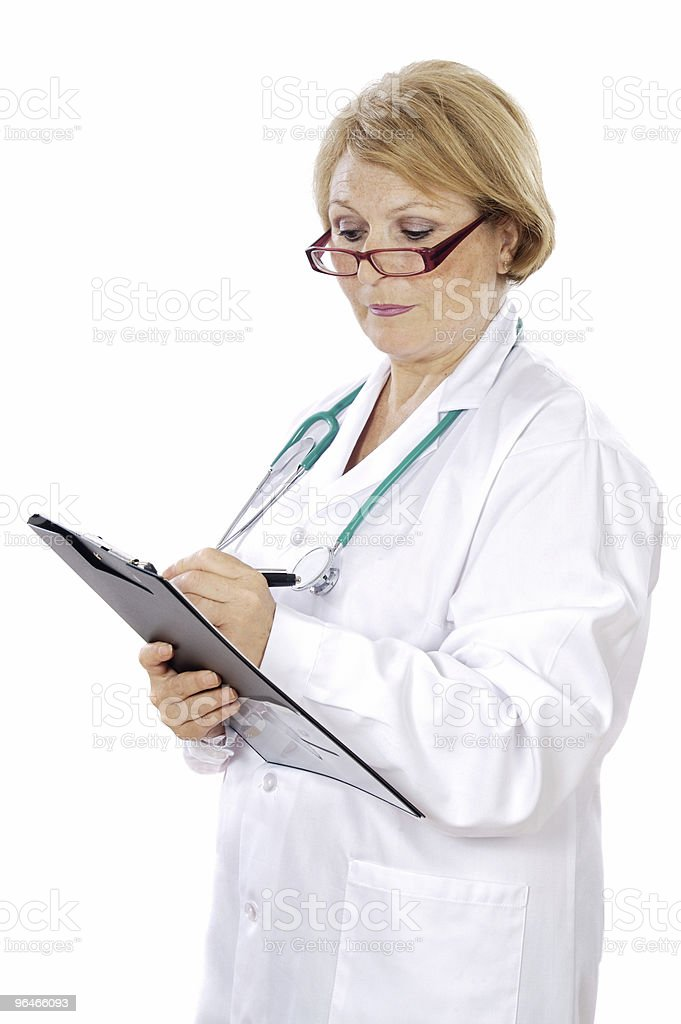 doctor writing royalty-free stock photo