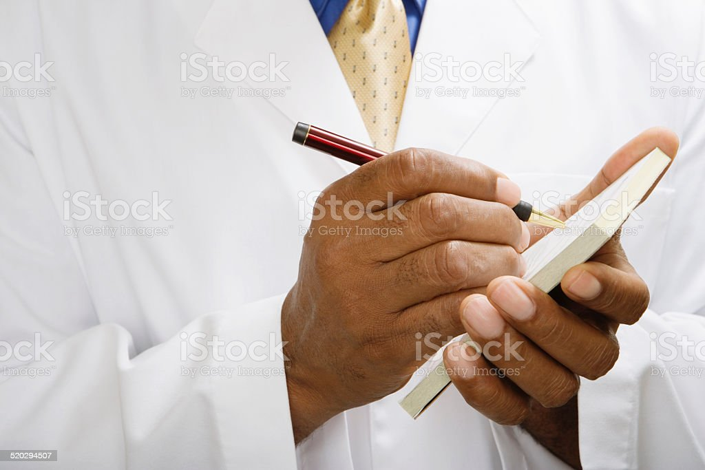 Doctor writing prescription, close-up stock photo