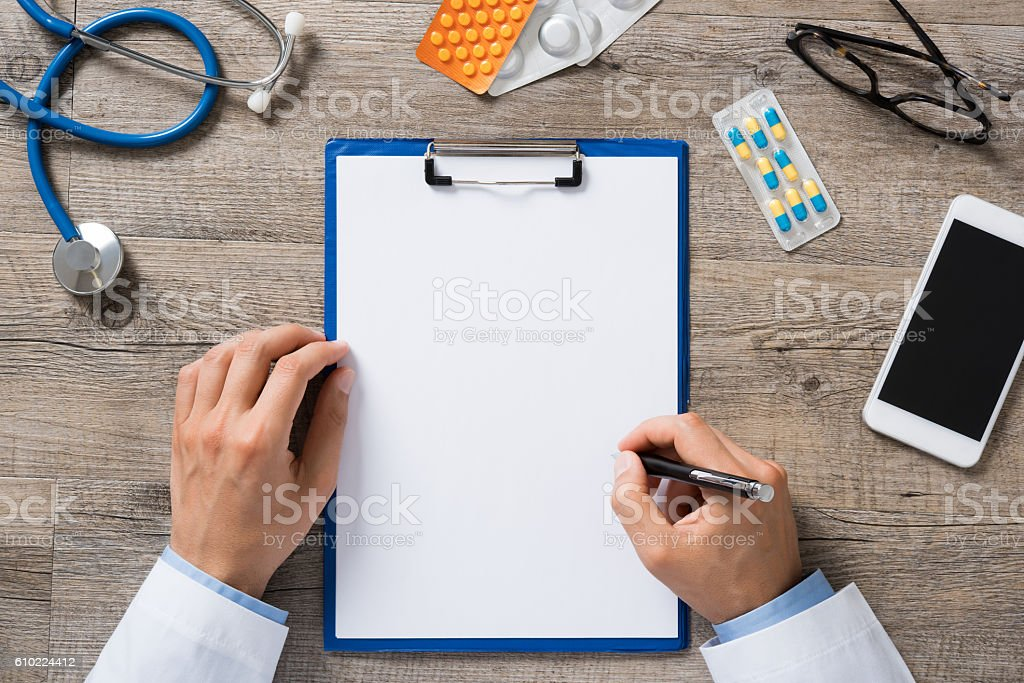 Doctor writing prescription stock photo