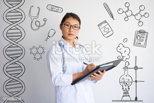 Doctor writing prescription with hand drawn medical sketches. Doctor occupation concept. Isolated closeup view with medicine icons on background.