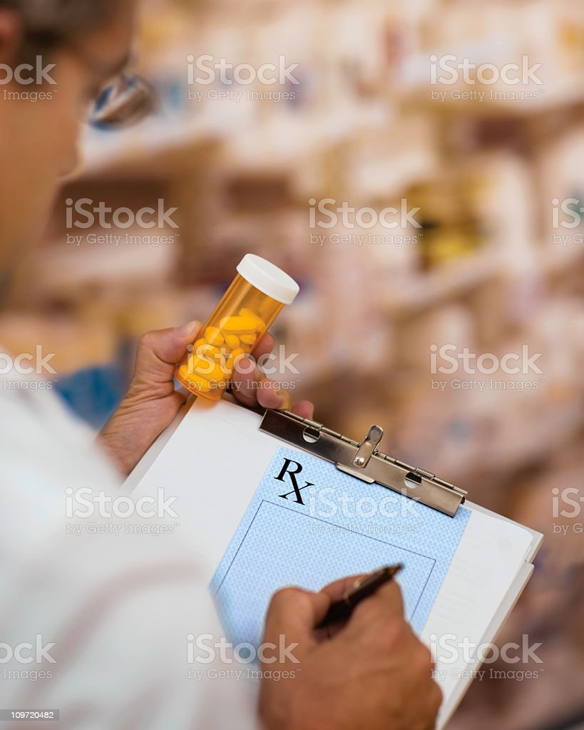 Doctor Writing Rx stock photo