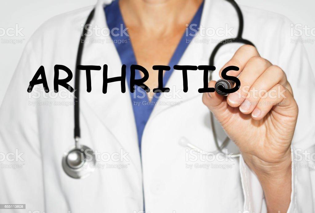 Doctor escritura palabra concepto médico de la artritis - foto de stock