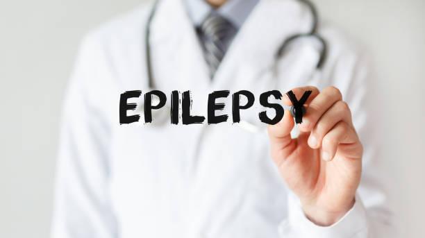Arzt schreiben Wort Epilepsie mit Marker, medizinisches Konzept – Foto