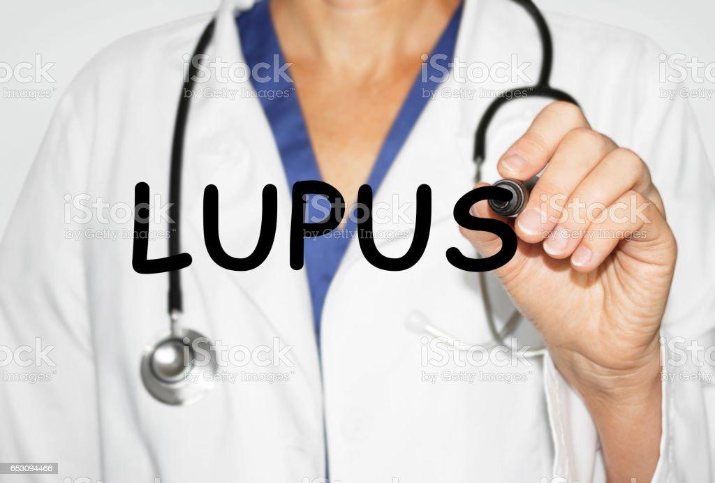 Arzt schriftlich Wort Lupus, medizinisches Konzept – Foto