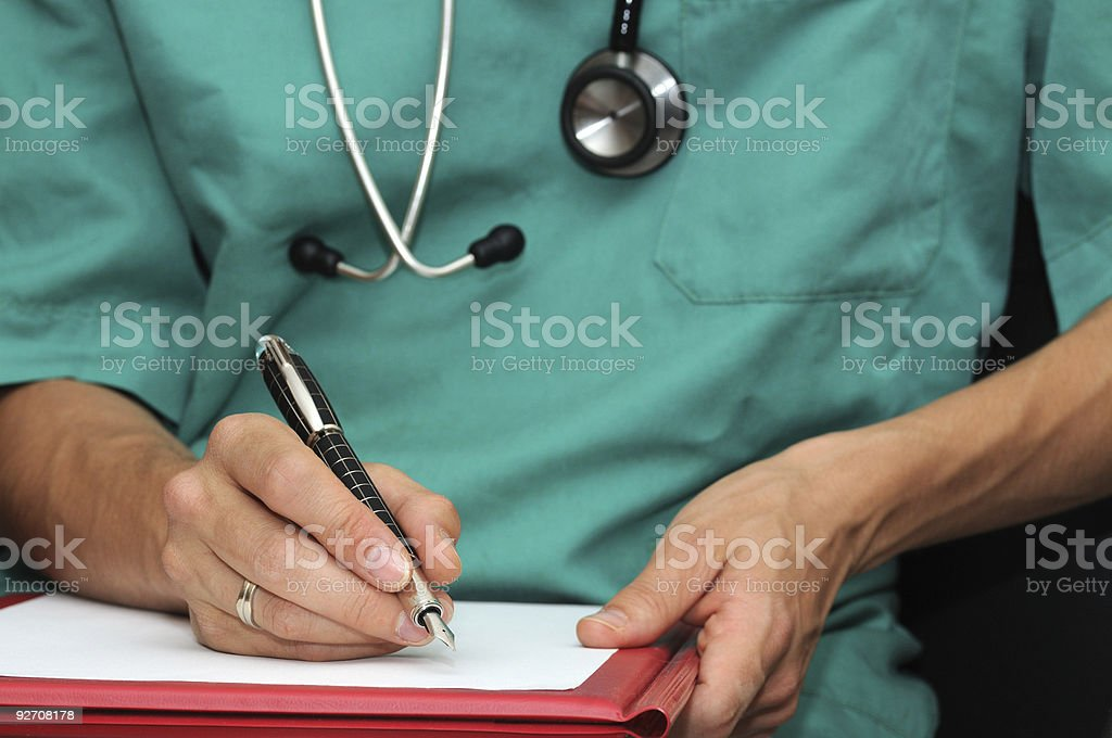 Doctor writting stock photo