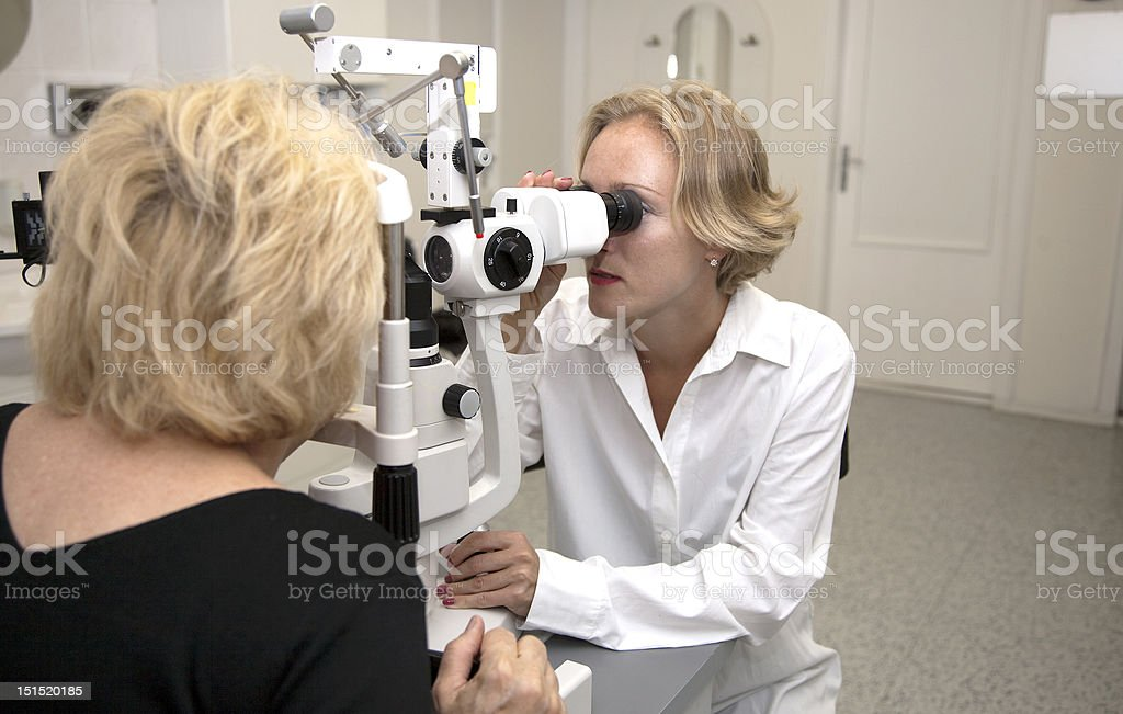 doctor,examining a patient in ophthalmology laboratory royalty-free stock photo