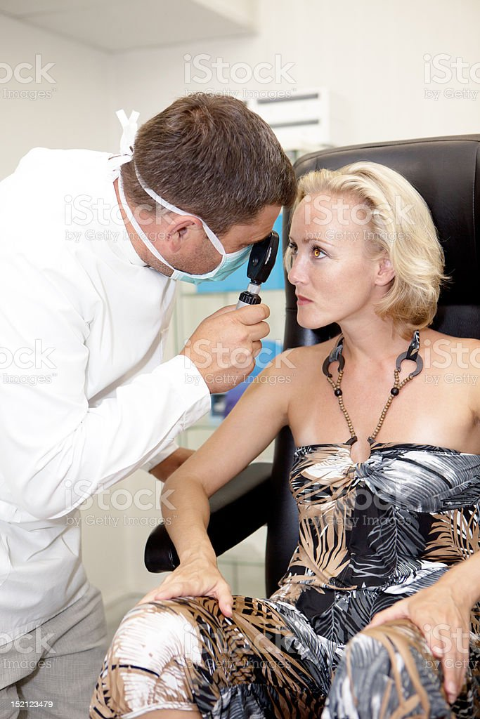 Doctor,examining a patient royalty-free stock photo