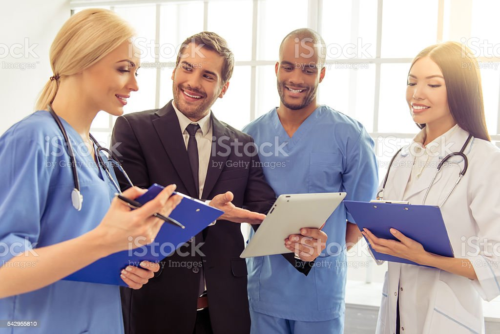 Doctors and businessman​​​ foto
