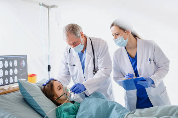 Doctors and infected patient in quarantine in hospital, coronavirus concept. stock photo