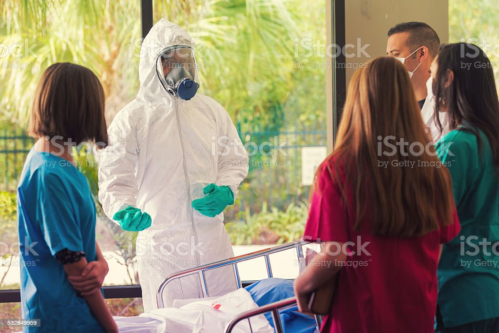 Doctors and nurses being trained to contain hazardous contagious diseases stock photo