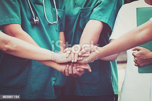 istock Doctors and nurses coordinate hands. Concept Teamwork 663981194
