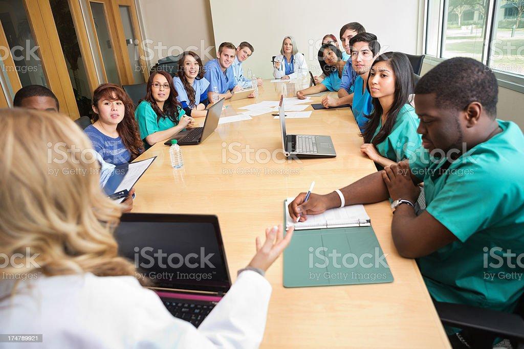 Doctors And Nurses Having Hospital Staff Meeting In Board ...