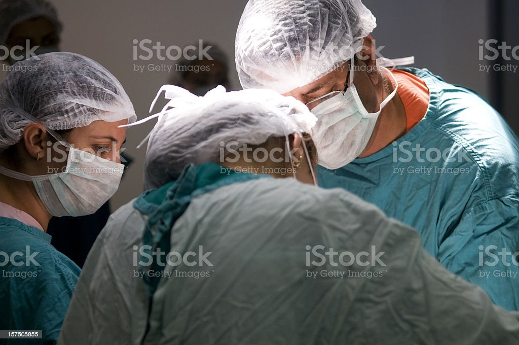 Doctors and nurses on operation royalty-free stock photo
