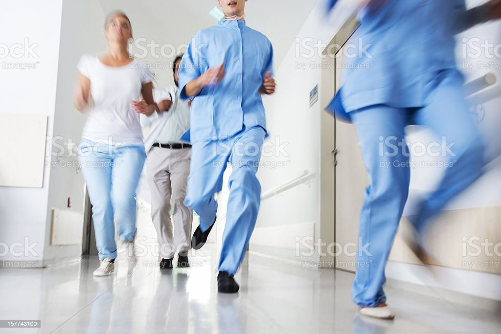 Doctors and nurses rushes for emergency in hospital corridor stock photo