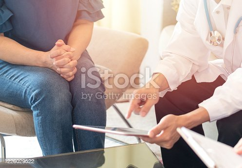 istock Doctors and patient healthcare concept. Gynecologist physician team consulting and examining woman patient health in Obstetrics and Gynecology department in medical hospital health service center. 1226029522