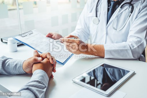 964904920 istock photo Doctors and patients consulting and diagnostic examining sit and talk. At the table near the window in the hospital medicine concept 1173046840