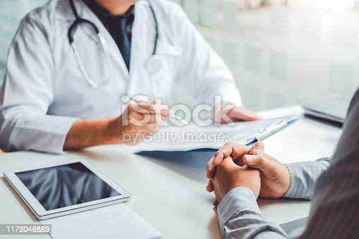 964904920 istock photo Doctors and patients consulting and diagnostic examining sit and talk. At the table near the window in the hospital medicine concept 1173046889