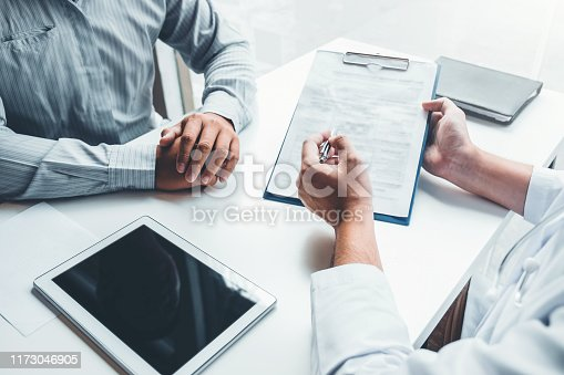 964904920 istock photo Doctors and patients consulting and diagnostic examining sit and talk. At the table near the window in the hospital medicine concept 1173046905
