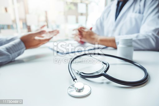 istock Doctors and patients consulting and diagnostic examining sit and talk. At the table near the window in the hospital medicine concept 1173046912