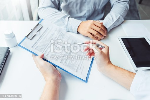 964904920 istock photo Doctors and patients consulting and diagnostic examining sit and talk. At the table near the window in the hospital medicine concept 1173046916