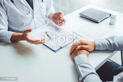 964904920 istock photo Doctors and patients consulting and diagnostic examining sit and talk. At the table near the window in the hospital medicine concept 1173046922