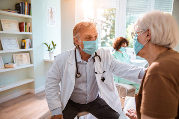 Doctors Appointment Close up of a senior woman consulting with her doctor in the office general practitioner stock pictures, royalty-free photos & images