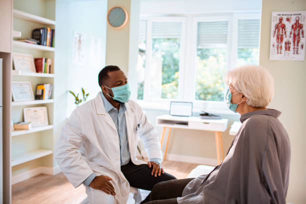 Doctors Appointment Close up of a senior woman having a doctors appointment general practitioner stock pictures, royalty-free photos & images