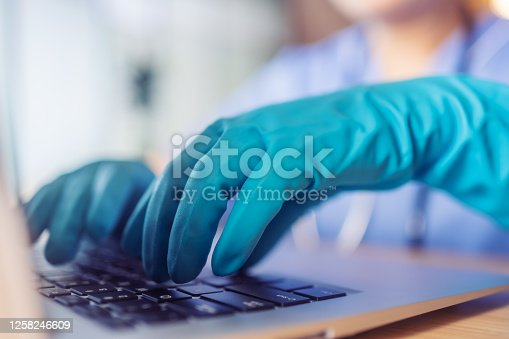 Doctors are using computer with gloves