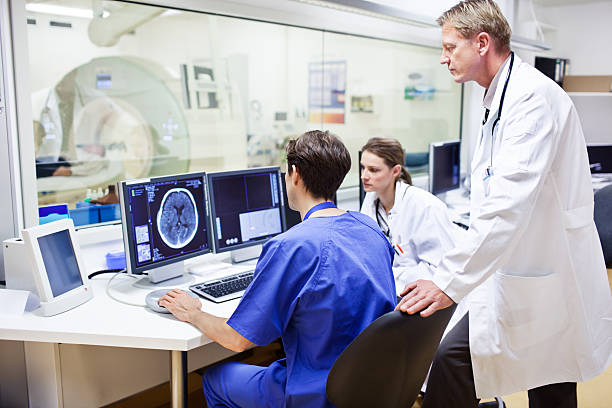 Doctors at a computer tomography exam stock photo