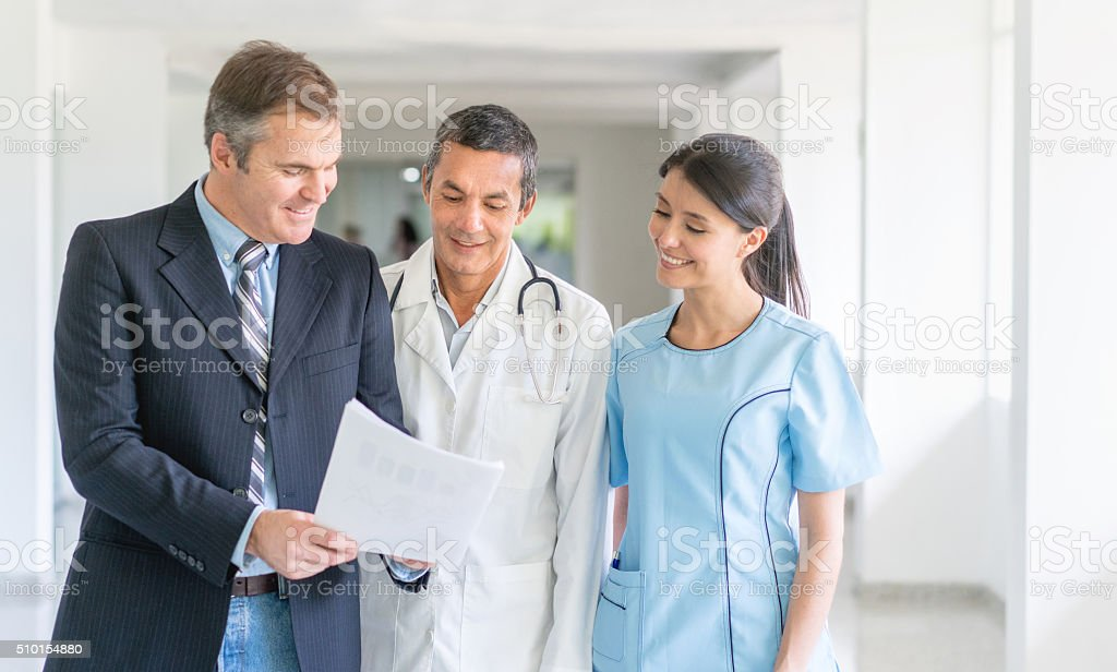 Doctors at the hospital talking about health insurance stock photo
