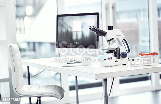 Shot of a desk with scientific equipment on it inside of a laboratory