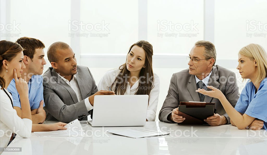 Doctors collaborating with a business team. stock photo