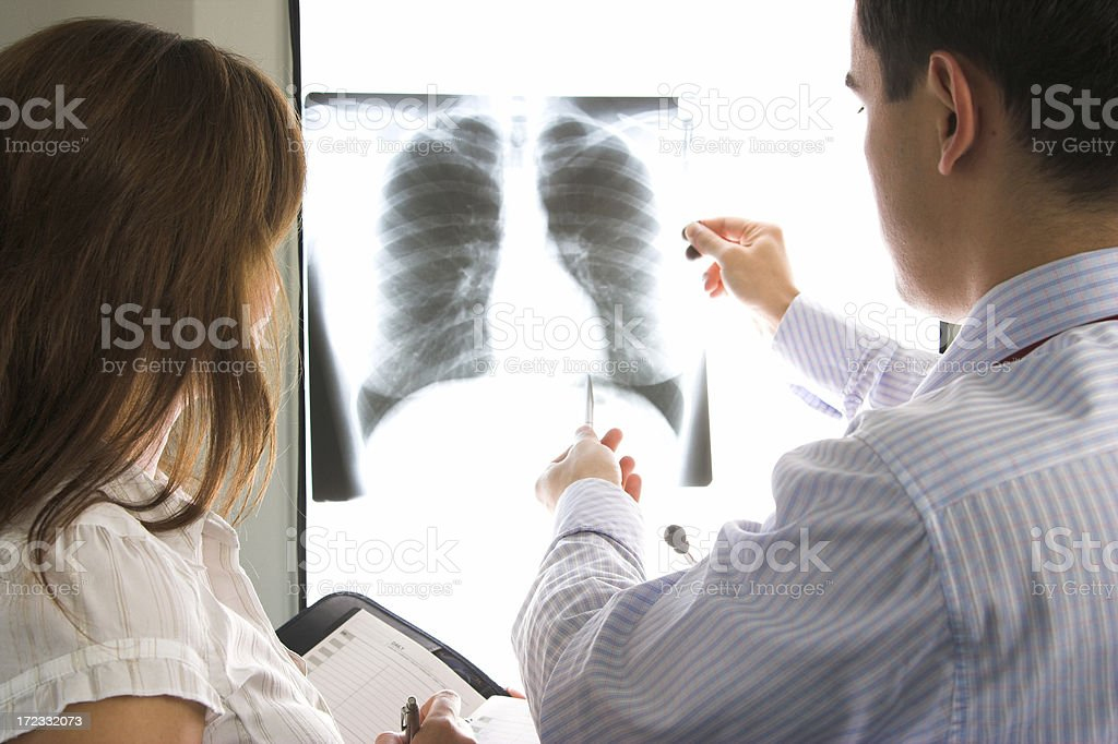 Doctors consult over an X-ray stock photo